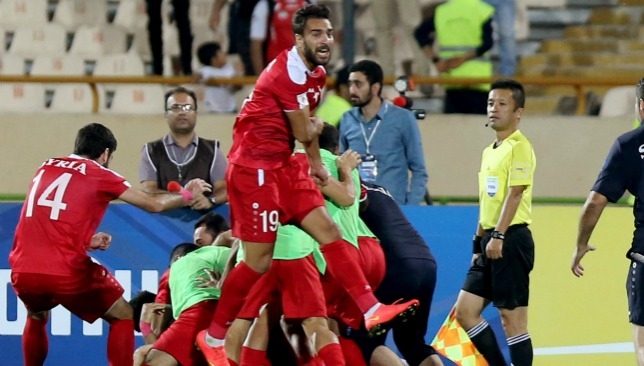 Syria celebrate a dramatic draw in their first-leg play-off with Australia.