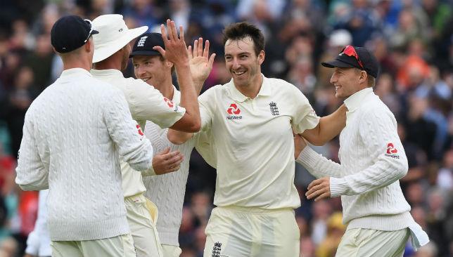 Toby Roland-Jones celebrates claiming a wicket.