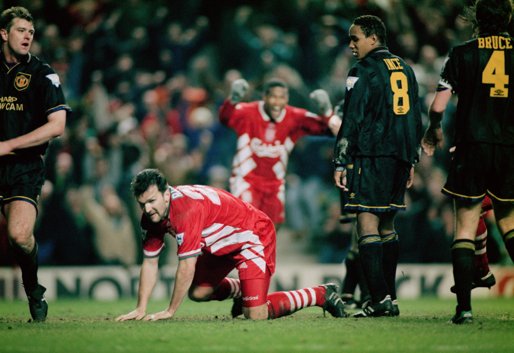 Neil Ruddock of Liverpool heads in the third goal against Manchester United as Paul Ince looks on, Anfield Liverpool, 4th January 1994. The Premier League game went on to finish 3 - 3. (Photo by Clive Brunskill/Getty Images)