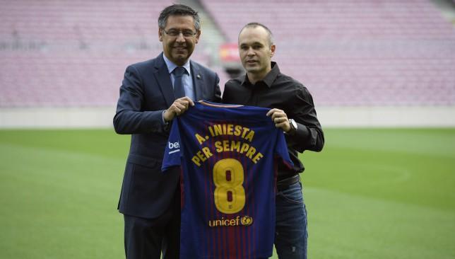 Club president Josep Maria Bartomeu with icon Iniesta.