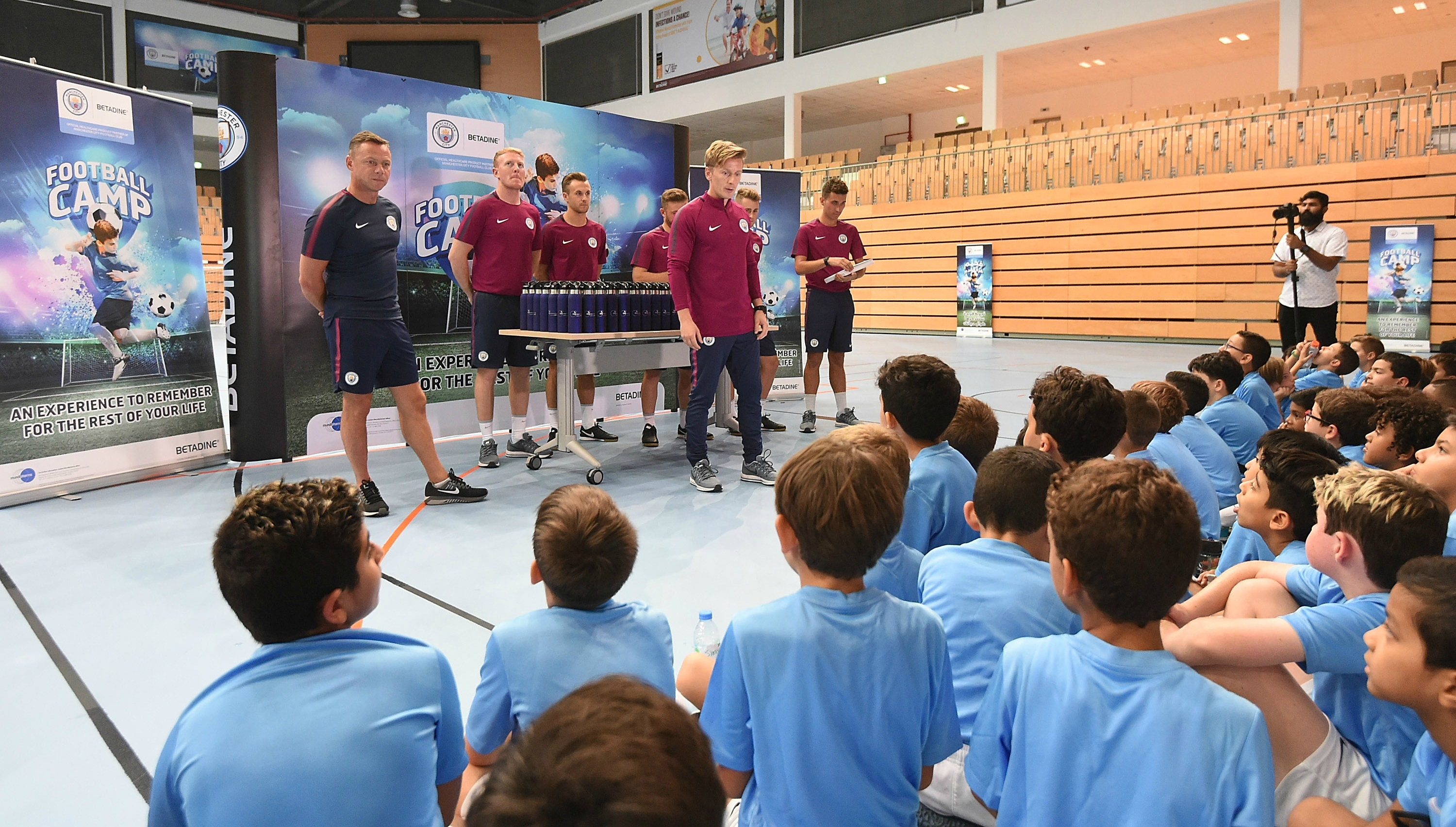 Paul Dickov (l) talking to Manchester City academy students in Abu Dhabi