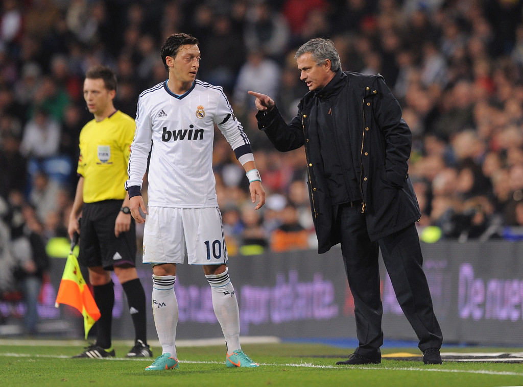 Jose Mourinho chats to Ozil during their time together at Madrid