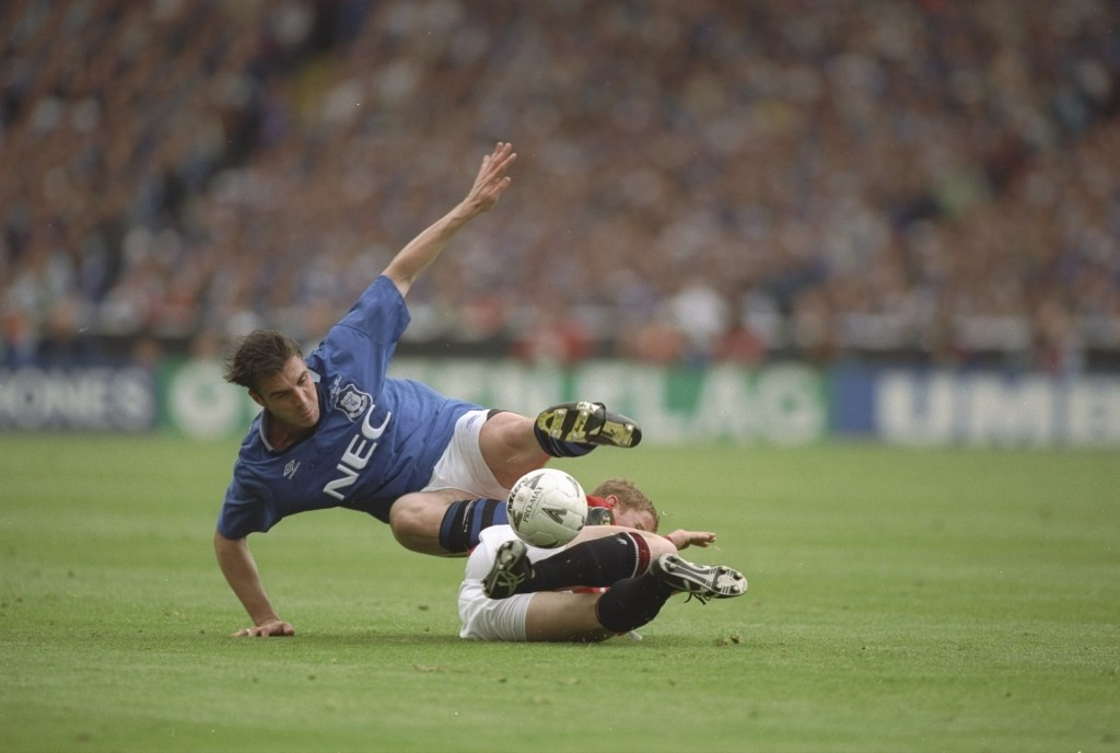 20 May 1995: Nicky Butt of Manchester United slides in to tackle David Unsworth of Everton during the FA Cup Final at Wembley Stadium in London. Everton won the match 1-0. Mandatory Credit: Clive Brunskill/Allsport