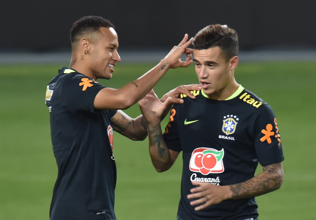 Neymar (L) and Philippe Coutinho joke during Brazil training
