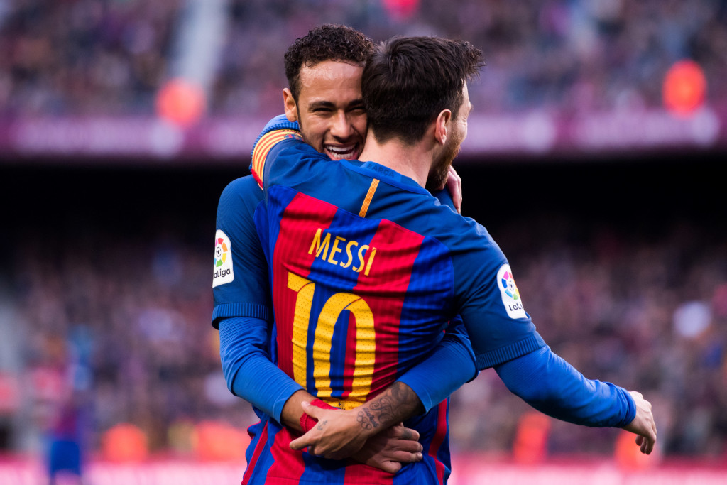 Neymar and Messi celebrate last season