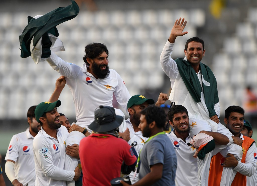 Retiring Pakistan cricket team members captain Misbah-ul-Haq (L) and Younis Khan (R) are carried by teammates as they celebrate after winning the final test match and the series 2-1 against the West Indies at the Windsor Park Stadium in Roseau, Dominica on May 14, 2017. / AFP PHOTO / MARK RALSTON (Photo credit should read MARK RALSTON/AFP/Getty Images)