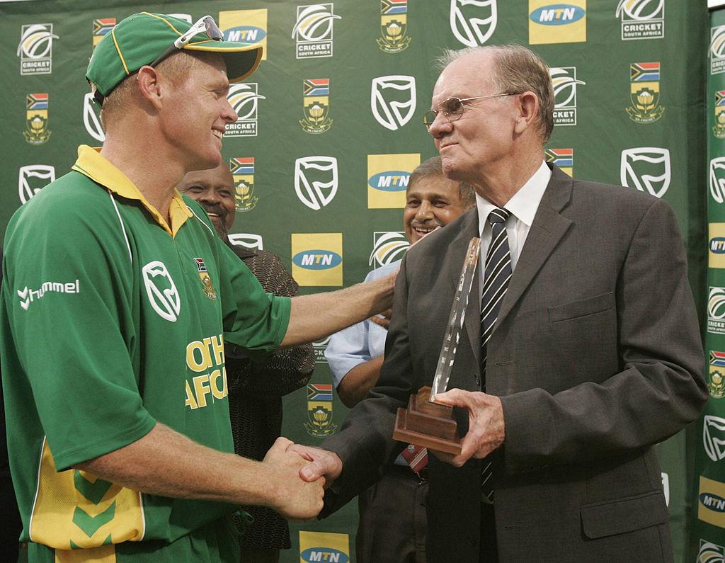 Shaun Pollock receives an award from his father.