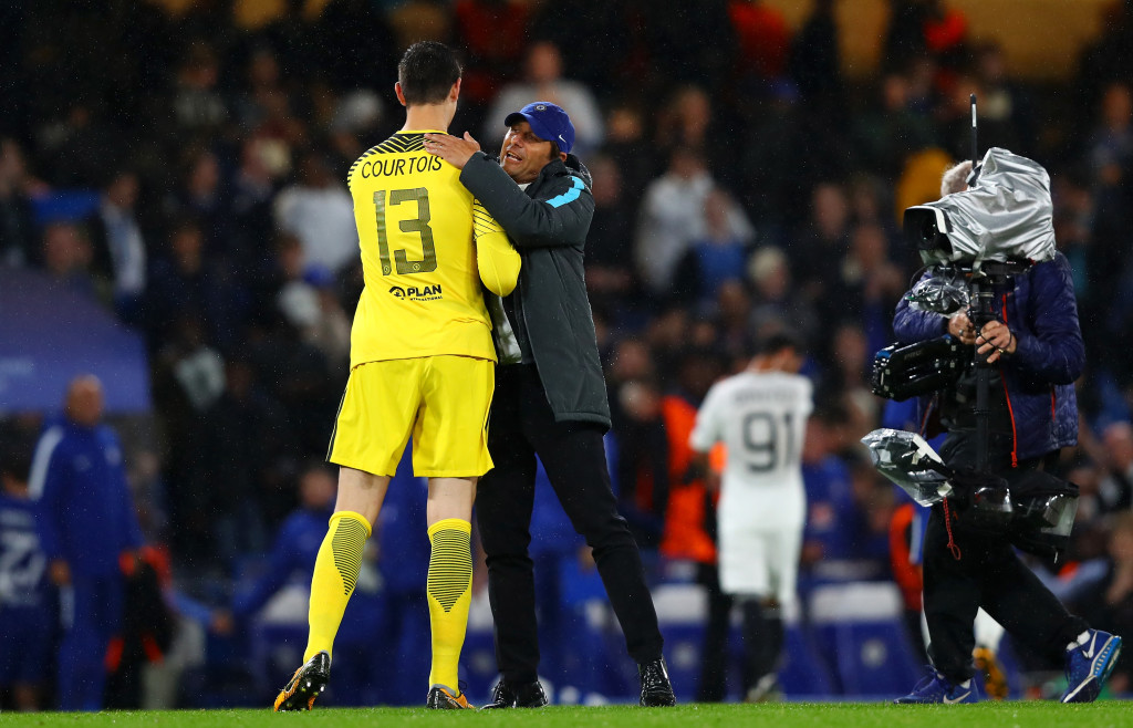 LONDON, ENGLAND - SEPTEMBER 12: Thibaut Courtois of Chelsea and Antonio Conte, Manager of Chelsea celebrate victory together after the UEFA Champions League Group C match between Chelsea FC and Qarabag FK at Stamford Bridge on September 12, 2017 in London, United Kingdom. (Photo by Clive Rose/Getty Images)