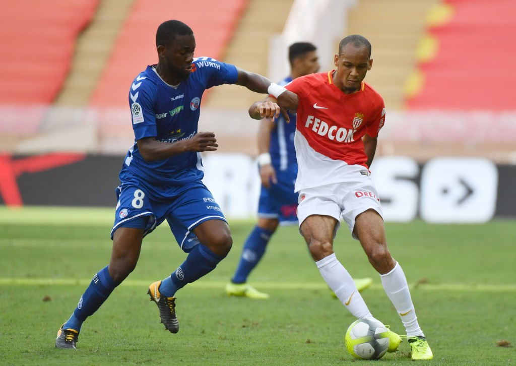 Monaco's Brazilian defender Fabinho (R) vies for the ball against Strasbourg's Ivory Coast's midfielder Jean-Eudes Aholou during the French Ligue 1 football match ASM Monaco against Strasbourg on September 16, 2017 at the Louis II Stadium in Monaco. / AFP PHOTO / YANN COATSALIOU (Photo credit should read YANN COATSALIOU/AFP/Getty Images)