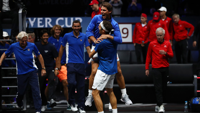 Special moments: Nadal and Federer celebrate.
