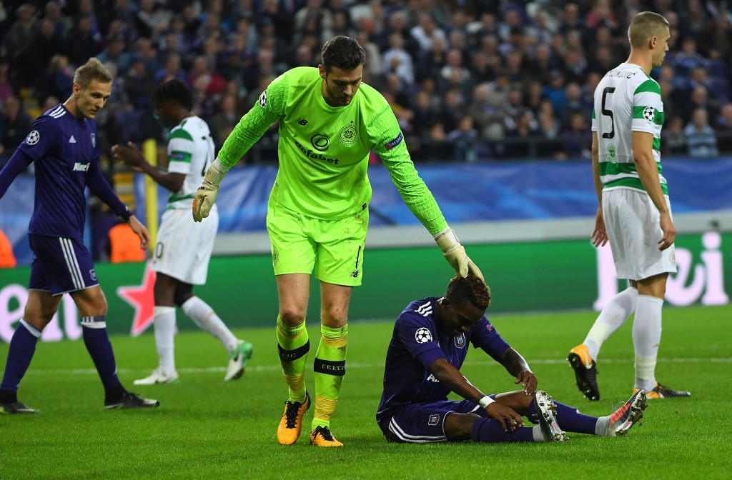 Henry Onyekuru is consoled by Craig Gordan in the Champions League