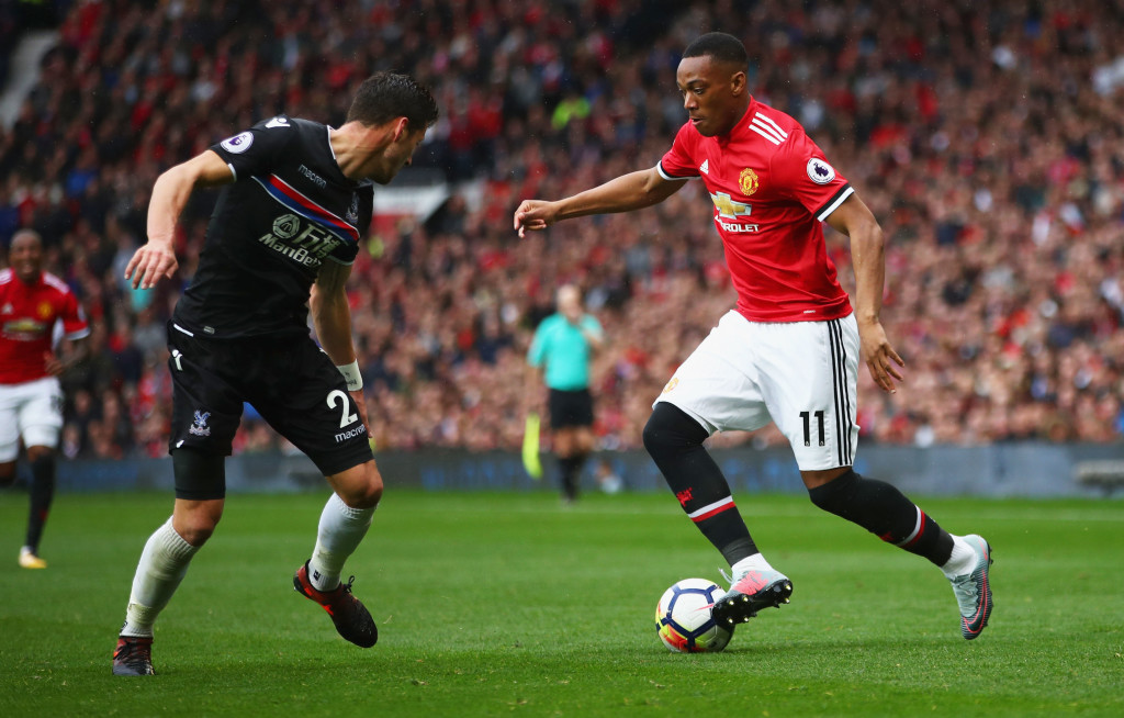 MANCHESTER, ENGLAND - SEPTEMBER 30: Anthony Martial of Manchester United attempts to get past Joel Ward of Crystal Palace during the Premier League match between Manchester United and Crystal Palace at Old Trafford on September 30, 2017 in Manchester, England. (Photo by Clive Brunskill/Getty Images)