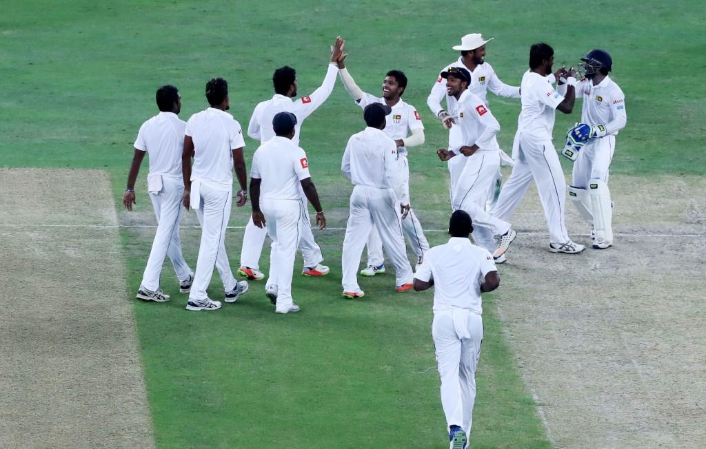 Sri Lanka players celebrate during the fourth day of the second Test between Pakistan and Sri Lanka at Dubai International Cricket Ground, in Dubai on October 9, 2017. / AFP PHOTO / KARIM SAHIB        (Photo credit should read KARIM SAHIB/AFP/Getty Images)