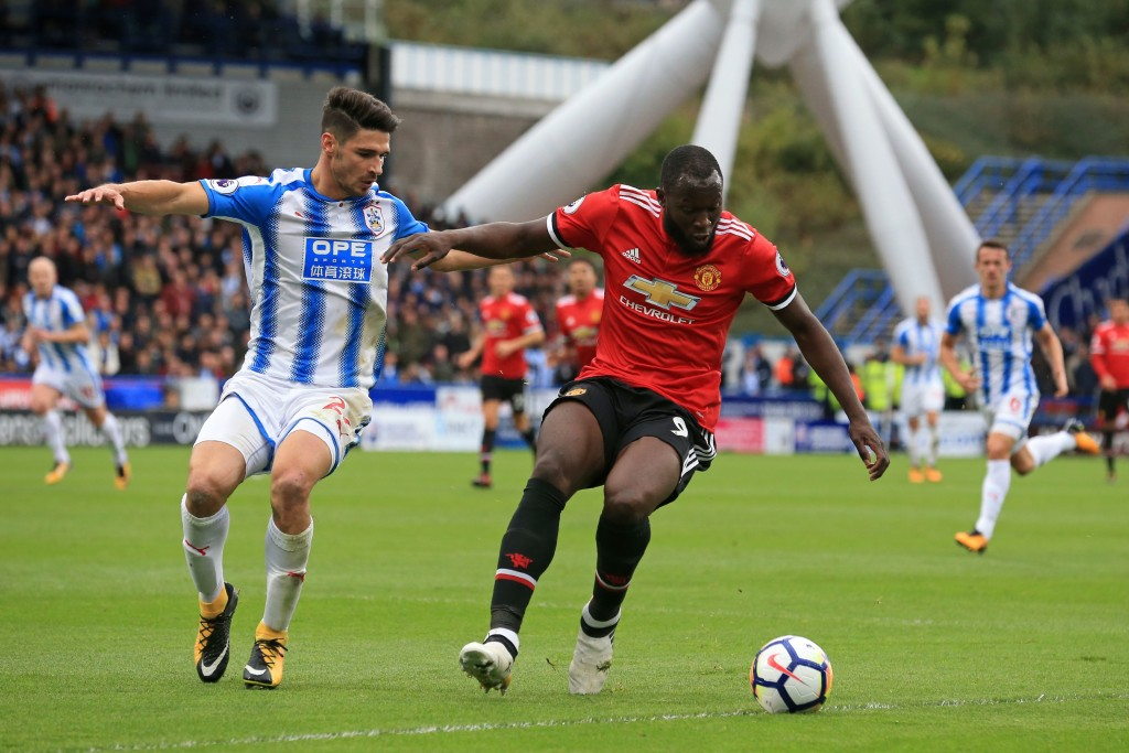Huddersfield Town's German defender Christopher Schindler (L) vies with Manchester United's Belgian striker Romelu Lukaku during the English Premier League football match between Huddersfield Town and Manchester United at the John Smith's stadium in Huddersfield, northern England on October 21, 2017. / AFP PHOTO / Lindsey PARNABY / RESTRICTED TO EDITORIAL USE. No use with unauthorized audio, video, data, fixture lists, club/league logos or 'live' services. Online in-match use limited to 75 images, no video emulation. No use in betting, games or single club/league/player publications. / (Photo credit should read LINDSEY PARNABY/AFP/Getty Images)