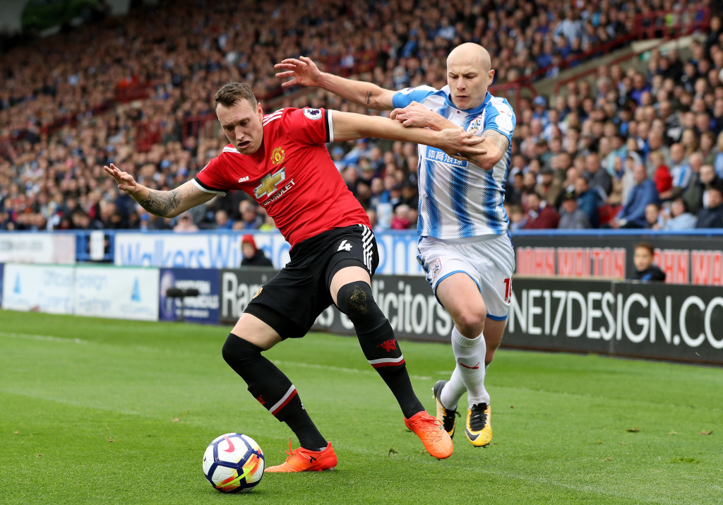 HUDDERSFIELD, ENGLAND - OCTOBER 21: Jmu4q of Manchester United holds off Aaron Mooy of Huddersfield Town during the Premier League match between Huddersfield Town and Manchester United at John Smith's Stadium on October 21, 2017 in Huddersfield, England. (Photo by Matthew Lewis/Getty Images)