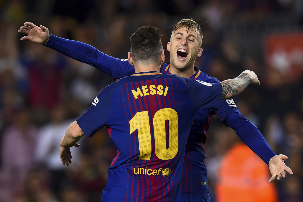 Barcelona's forward Gerard Deulofeu (R) celebrates with Barcelona's Argentinian forward Lionel Messi after scoring a goal during the Spanish league football match FC Barcelona vs Malaga CF at the Camp Nou stadium in Barcelona on October 21, 2017. / AFP PHOTO / Josep LAGO (Photo credit should read JOSEP LAGO/AFP/Getty Images)