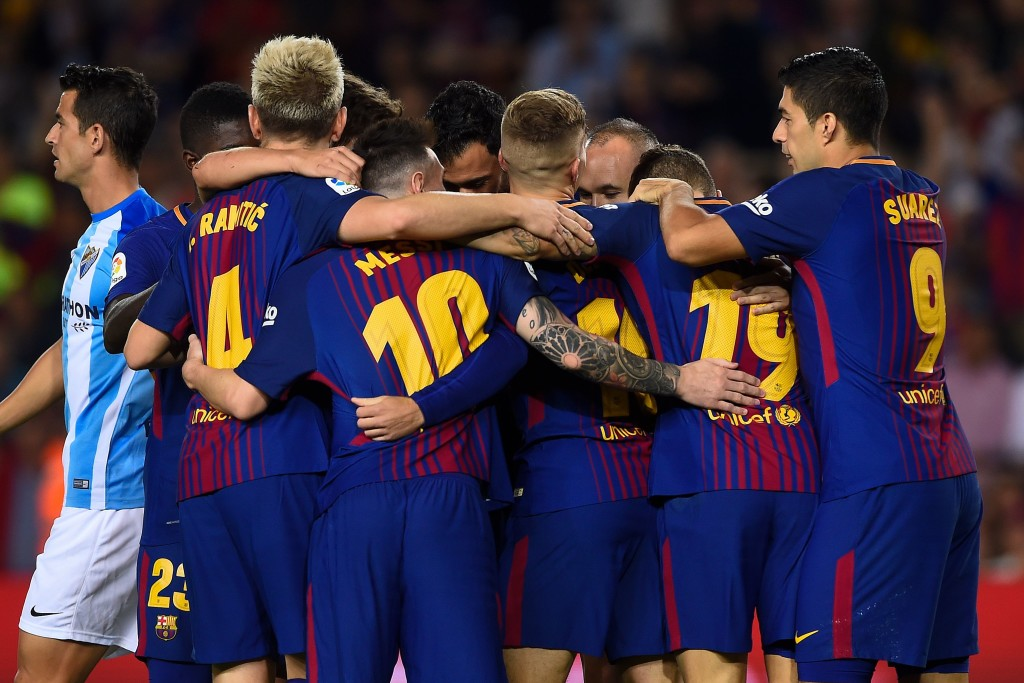 Barcelona's players celebrate a goal during the Spanish league football match FC Barcelona vs Malaga CF at the Camp Nou stadium in Barcelona on October 21, 2017. / AFP PHOTO / Josep LAGO (Photo credit should read JOSEP LAGO/AFP/Getty Images)