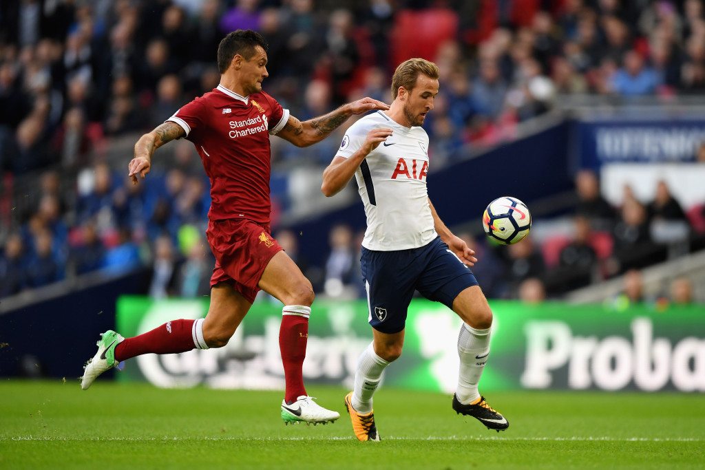 LONDON, ENGLAND - OCTOBER 22: Dejan Lovren of Liverpool and Harry Kane of Tottenham Hotspur battle for possession during the Premier League match between Tottenham Hotspur and Liverpool at Wembley Stadium on October 22, 2017 in London, England. (Photo by Shaun Botterill/Getty Images)