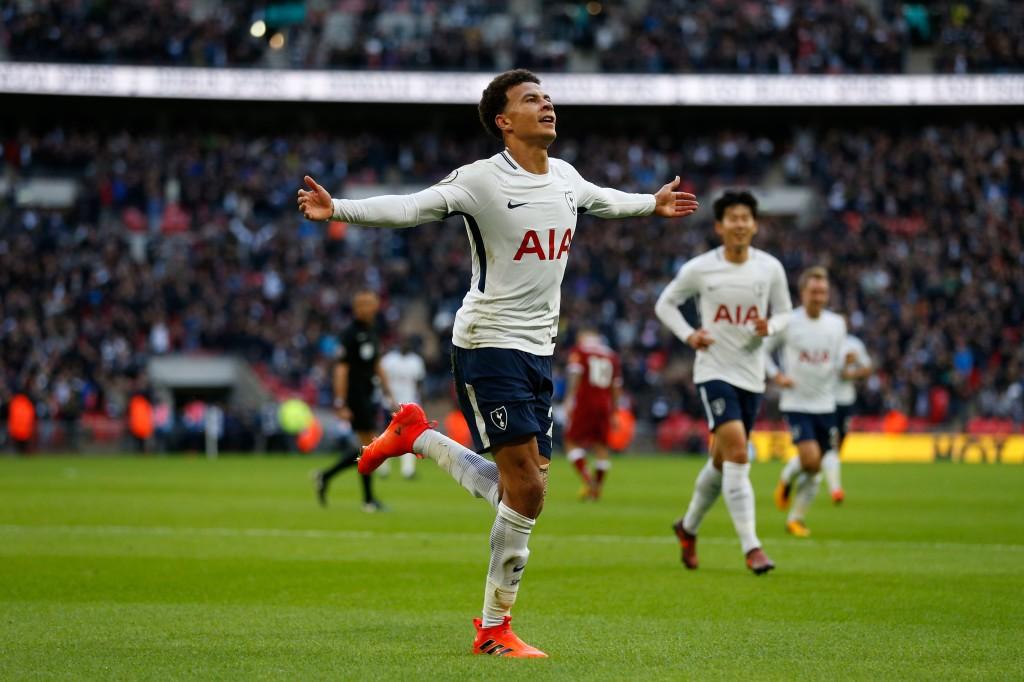 Alli celebrates his goal against Liverpool