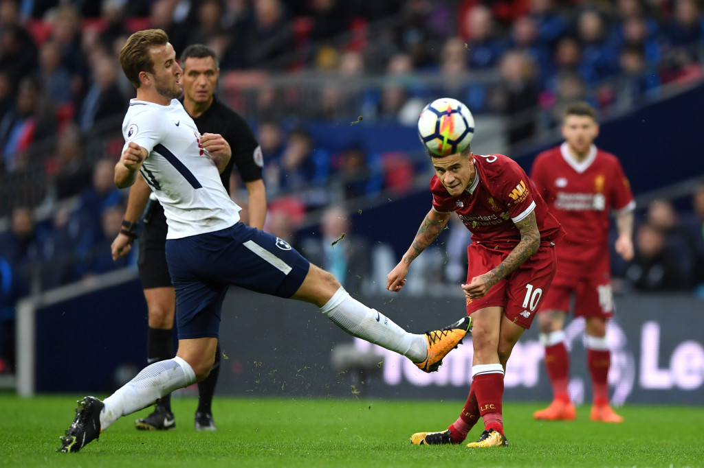 Kane attempts to block a Coutinho shot