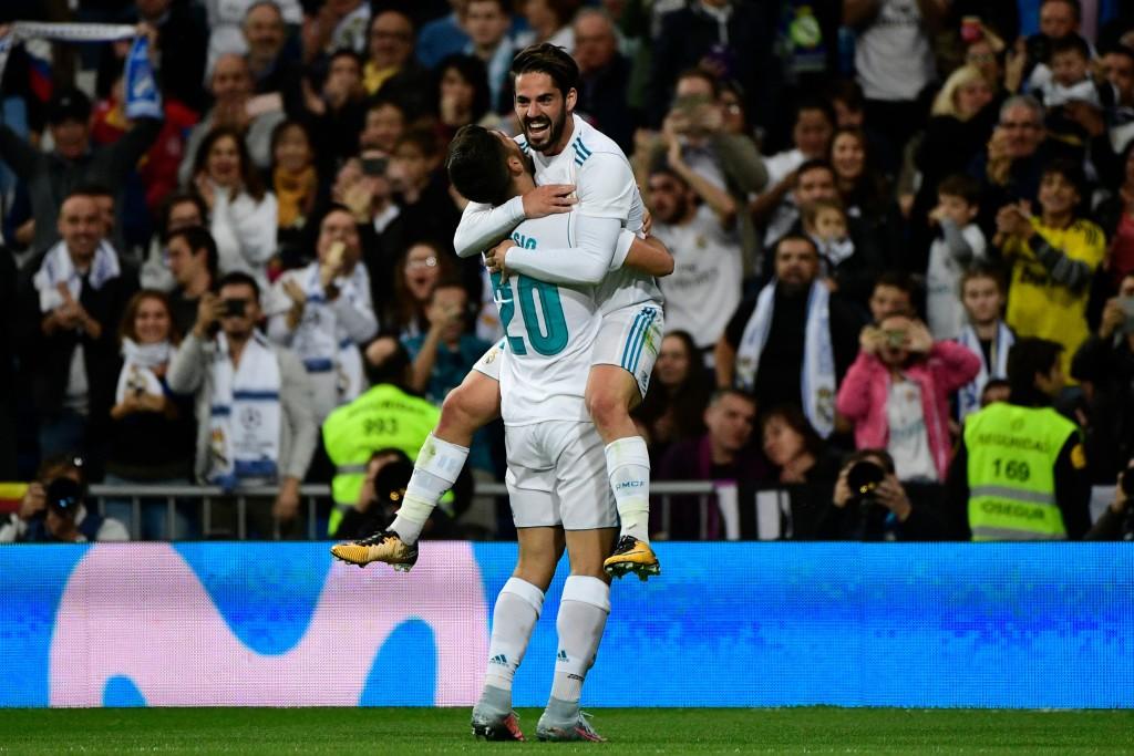 Marco Asensio celebrates his goal with Isco
