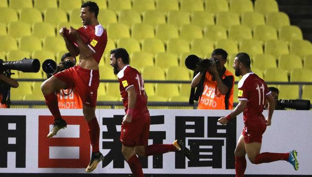 Omar Al Soma celebrates scoring Syria's only goal.