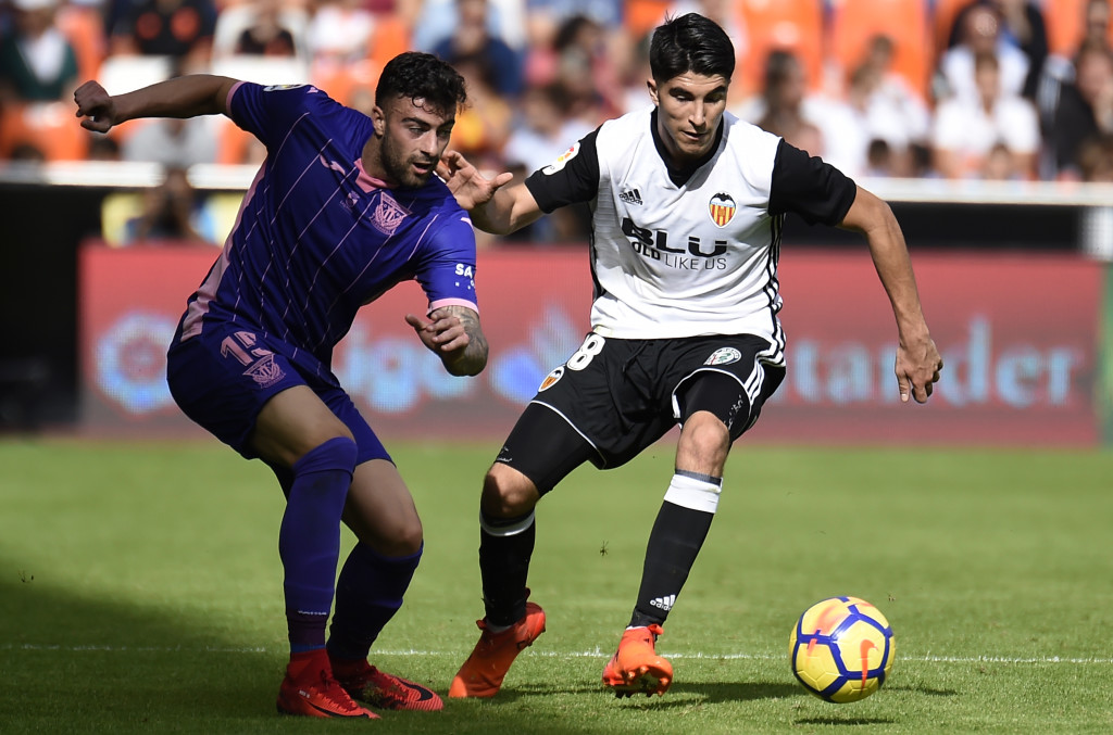 Carlos Soler (R) has caught the eye of Manchester United.