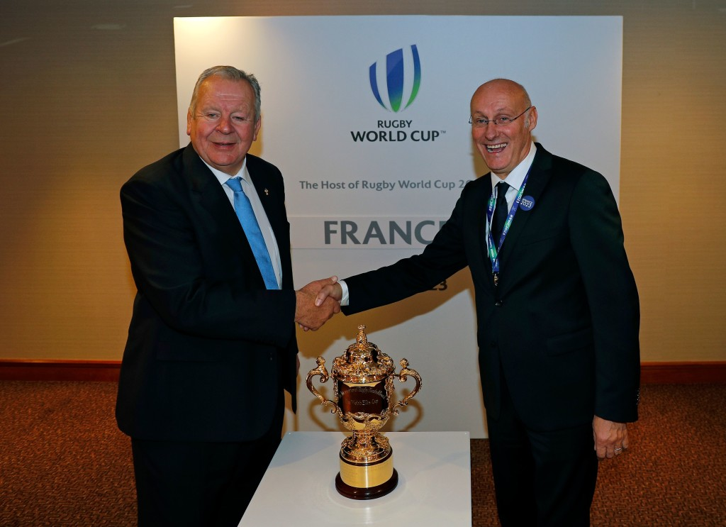 Chairman of World Rugby Bill Beaumont (L) shakes hands with French rugby President Bernard Laporte (R) after France is named to host the 2023 Rugby World Cup in London on November 15, 2017. France won the right to stage the 2023 World Cup, it was announced today, despite finishing behind rival bidders South Africa in an evaluation report. / AFP PHOTO / ADRIAN DENNIS (Photo credit should read ADRIAN DENNIS/AFP/Getty Images)