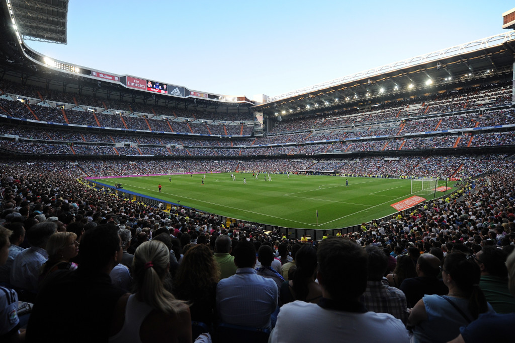 MADRID, SPAIN - AUGUST 25: Spectators watch the La liga match between Real Madrid CF and Cordoba CF at Estadio Santiago Bernabeu on August 25, 2014 in Madrid, Spain. (Photo by Denis Doyle/Getty Images)