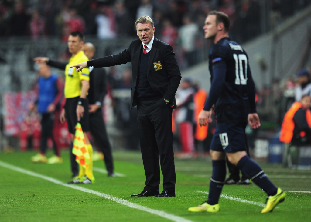 MUNICH, GERMANY - APRIL 09: David Moyes, manager of Manchester United gives instructions to Wayne Rooney during the UEFA Champions League Quarter Final second leg match between FC Bayern Muenchen and Manchester United at Allianz Arena on April 9, 2014 in Munich, Germany. (Photo by Shaun Botterill/Getty Images)