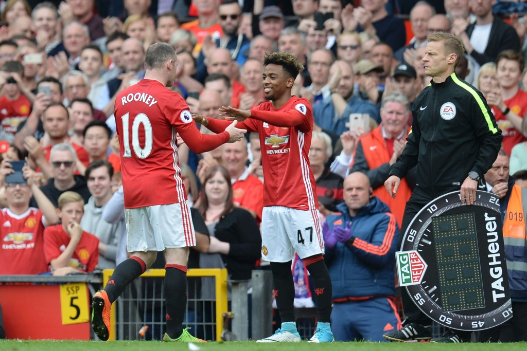 Manchester United's English striker Wayne Rooney (L) is substituted for Manchester United's English midfielder Angel Gomes (R) during the English Premier League football match between Manchester United and Cyrstal Palace at Old Trafford in Manchester, north west England, on May 21, 2017. / AFP PHOTO / Oli SCARFF / RESTRICTED TO EDITORIAL USE. No use with unauthorized audio, video, data, fixture lists, club/league logos or 'live' services. Online in-match use limited to 75 images, no video emulation. No use in betting, games or single club/league/player publications. / (Photo credit should read OLI SCARFF/AFP/Getty Images)