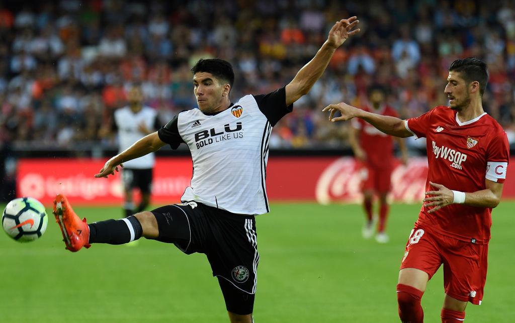Valencia's midfielder Carlos Soler (L)