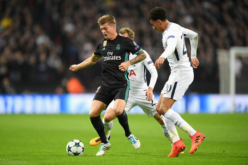 Toni Kroos is chased down by Christian Eriksen