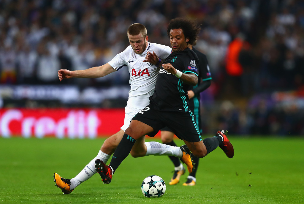 Marcelo and Eric Dier compete for the ball