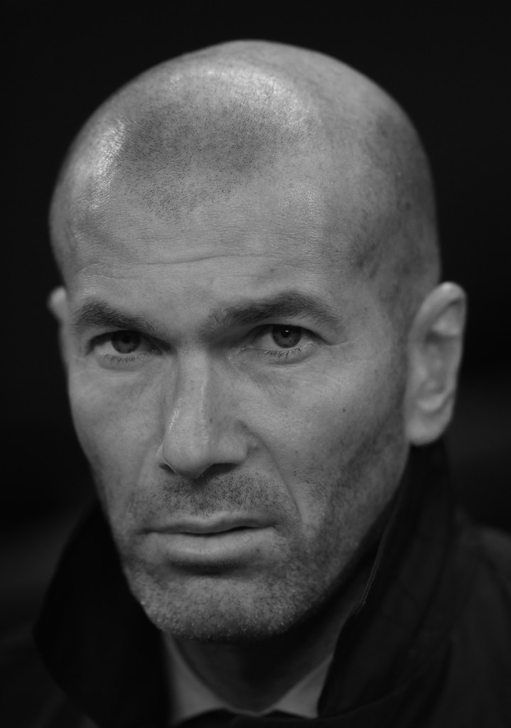 LONDON, ENGLAND - NOVEMBER 01: (EDITOR NOTES: This image has been converted to black and white) Zinedine Zidane of Real Madrid looks on during the UEFA Champions League group H match between Tottenham Hotspur and Real Madrid at Wembley Stadium on November 1, 2017 in London, United Kingdom. (Photo by Laurence Griffiths/Getty Images)