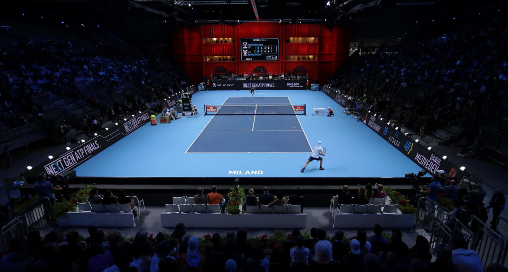 The backdrop of the court in Milan is a tribute to La Scala.