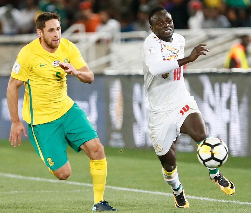 Senegal star Sadio Mane (r)