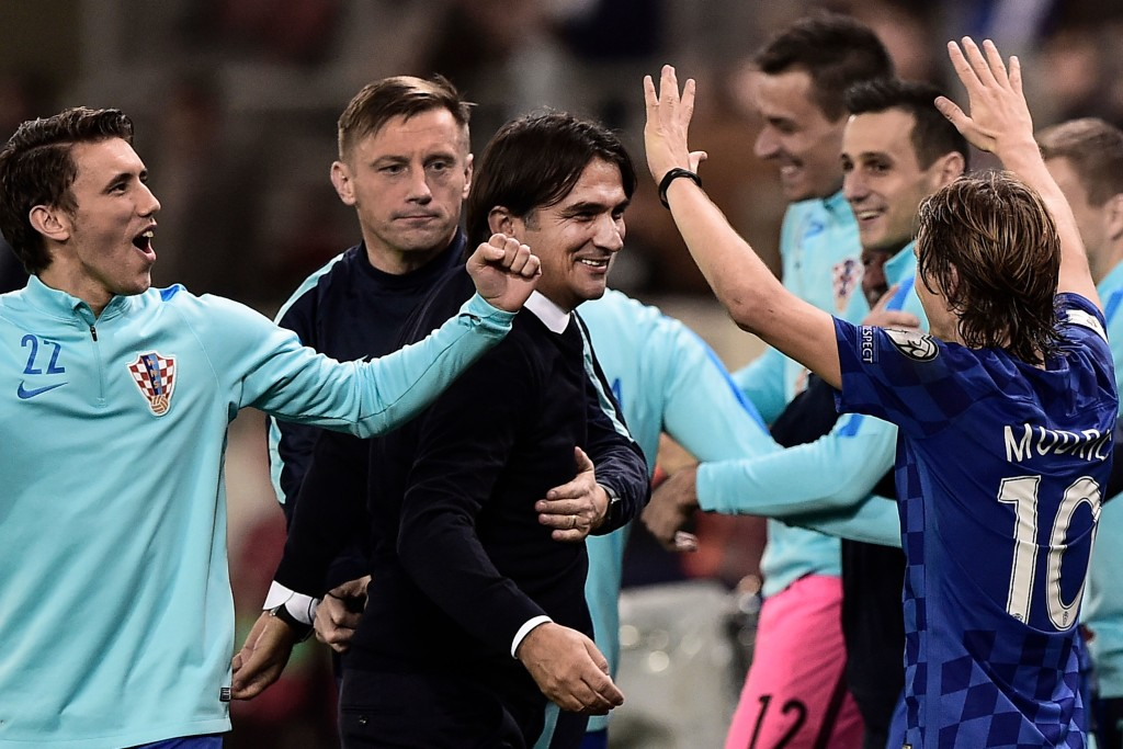 Croatia's head coach Zlatko Dalic (C) celebrates with his team