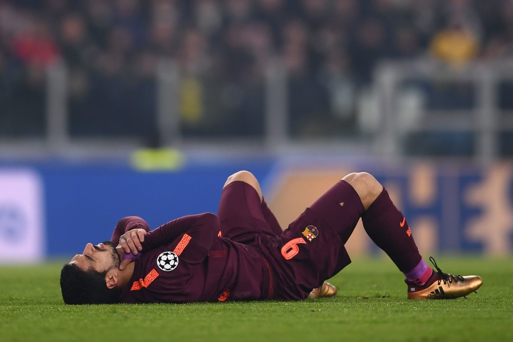 Luis Suarez does down injured during the draw with Juve