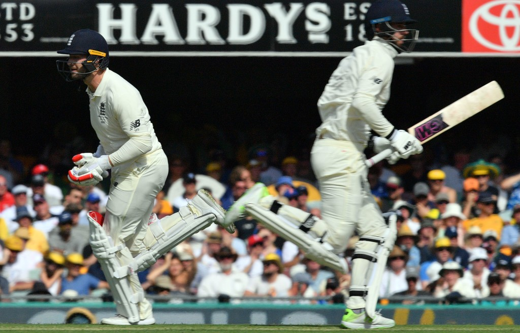 England's batsmen James Vince (R) and England's Mark Stoneman (R) run between the wickets on the first day of the first cricket Ashes Test between England and Australia in Brisbane on November 23, 2017. / AFP PHOTO / SAEED KHAN / --IMAGE RESTRICTED TO EDITORIAL USE - STRICTLY NO COMMERCIAL USE-- (Photo credit should read SAEED KHAN/AFP/Getty Images)