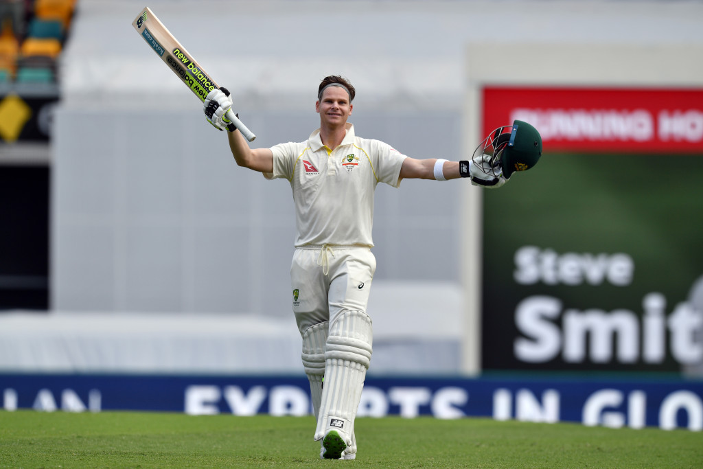 Australia's batsman Steve Smith celebrates his 100-runs on the third day of the first cricket Ashes Test between England and Australia in Brisbane on November 25, 2017. / AFP PHOTO / SAEED KHAN / -- IMAGE RESTRICTED TO EDITORIAL USE - STRICTLY NO COMMERCIAL USE -- (Photo credit should read SAEED KHAN/AFP/Getty Images)