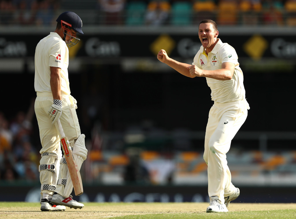 BRISBANE, AUSTRALIA - NOVEMBER 25: Josh Hazlewood of Australia celebrates after taking the wicket of Alastair Cook of England during day three of the First Test Match of the 2017/18 Ashes Series between Australia and England at The Gabba on November 25, 2017 in Brisbane, Australia. (Photo by Ryan Pierse/Getty Images)