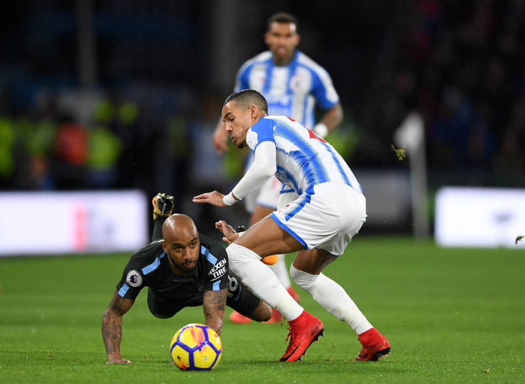 Tom Ince is tackled by Fabian Delph