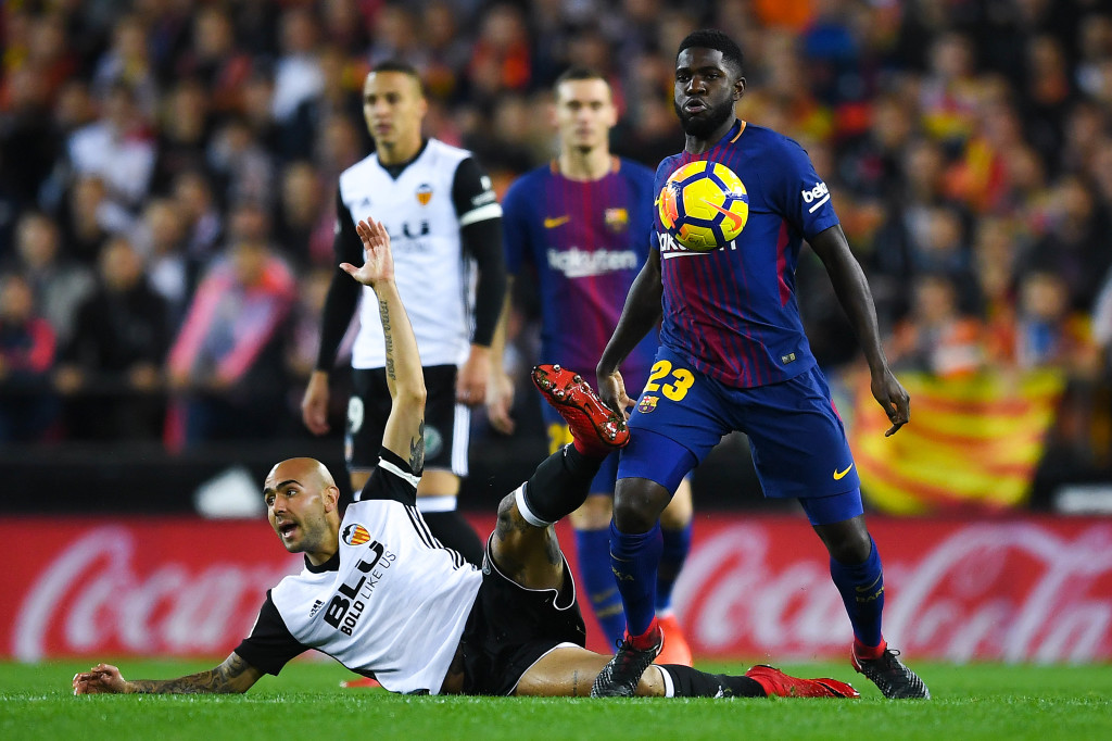 Simone Zaza attempts to tackle Samuel Umtiti