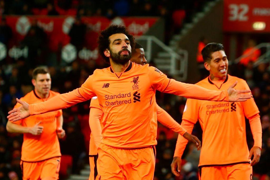 Mohamed Salah (C) celebrates scoring