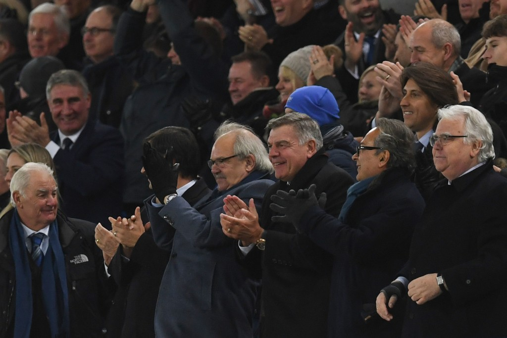 English football manager Sam Allardyce (C) celebrates after Wayne Rooney scored his third goal to complete his hattrick during the English Premier League football match between Everton and West Ham United at Goodison Park in Liverpool, north west England on November 29, 2017. / AFP PHOTO / Paul ELLIS / RESTRICTED TO EDITORIAL USE. No use with unauthorized audio, video, data, fixture lists, club/league logos or 'live' services. Online in-match use limited to 75 images, no video emulation. No use in betting, games or single club/league/player publications. / (Photo credit should read PAUL ELLIS/AFP/Getty Images)