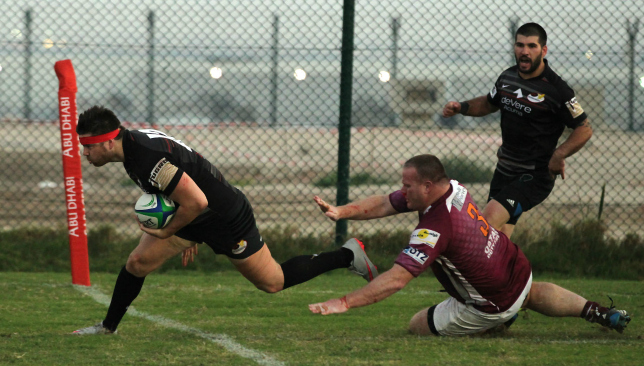Garth van Niekerk (l) goes over for a try against Doha at former club Saracens