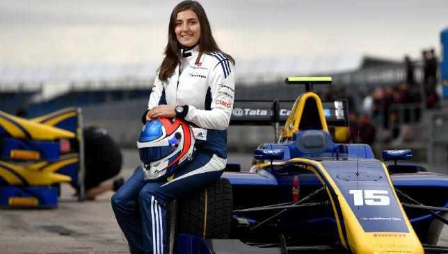 Next to her car: Tatiana Calderon