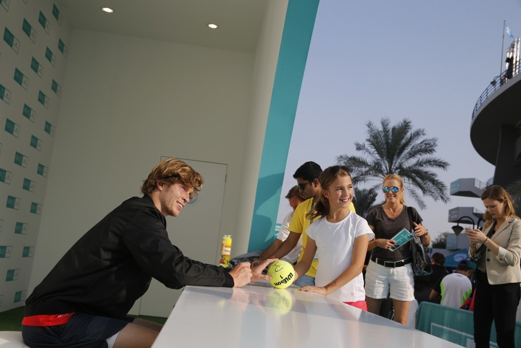 Andrey Rublev signs autographs for the starry-eyed fans.