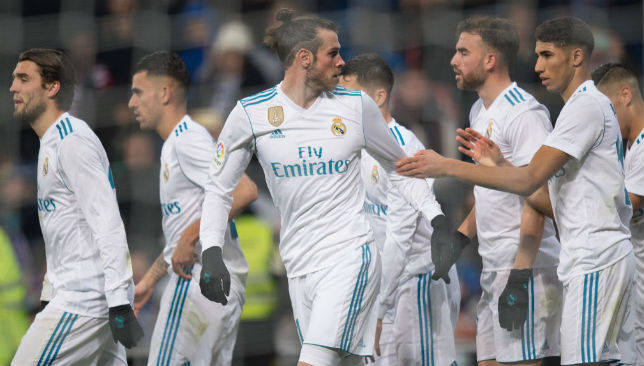 Celebrating a goal with his team mates: Gareth Bale